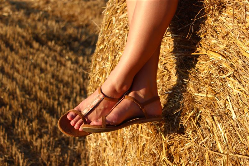 Womens feet on haystack