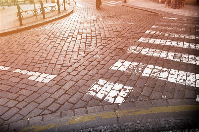 Paved crossroad at sunlight in Prague downtown