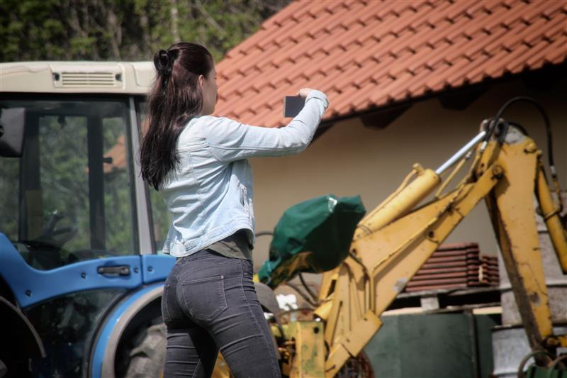 Woman documenting work on phone