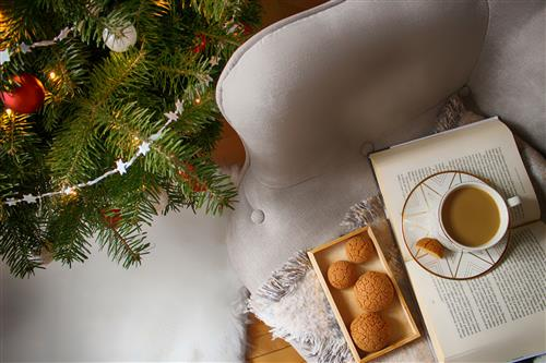 Christmas tree and cup of tea with cream puff