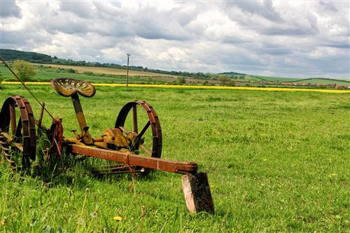 Old agricultural machine on a meadow