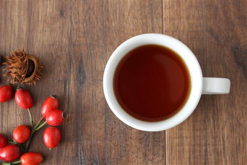 Rose hip tea on the wood table