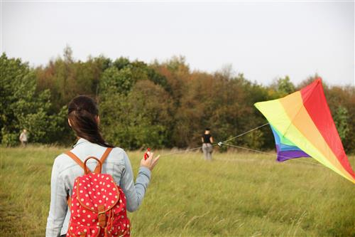 Woman and flying kite