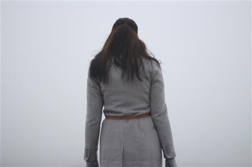 Woman looking into the fog